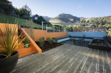 Burnt orange plastered walls and outdoor seating