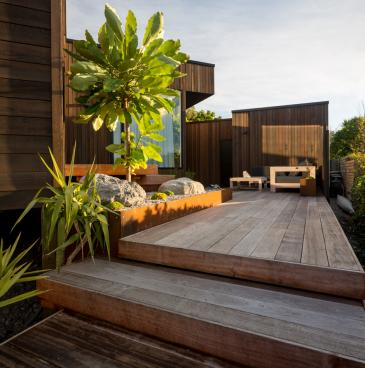 Hardwood deck, corten planter and boulders
