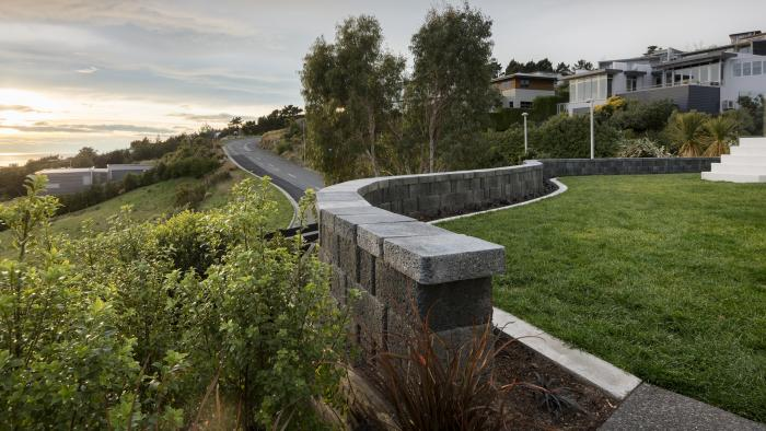 Curving concrete block retaining wall in Mt Pleasant, Christchurch