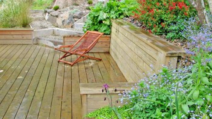 Deck area with edible garden behind T&G retaining wall