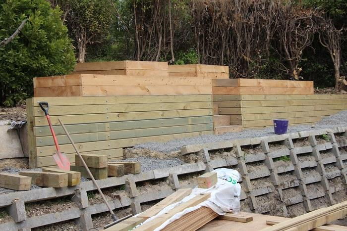 Retaining wall and macrocarpa raised planters